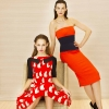 Left: a Victoria by Victoria Beckham cat print pleat dress 1,070.euro and right a Victoria Beckham orange and navy strapless dress 2,235,euro in Brown Thomas Dublin