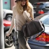 Model Rosie Huntington Whitely wears a fedora