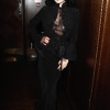Dita Von Teese attends as French shoe designer Christian Louboutin celebrates the opening of his exhibition at the Design Museum with an after party at The Club at The Ivy