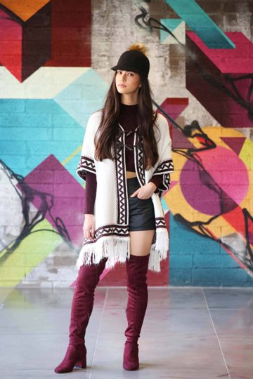 Pictured, Li Ann wears Poncho eur24, Burgundy Cropped Polo eur10, Coated Shorts eur11, Burgundy over the Knee Boots eur28, Cap eur9.