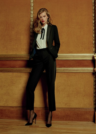 Tuxedo Jacket €20, Blouse €13, Trousers €14, Shoes €16, Tights €4