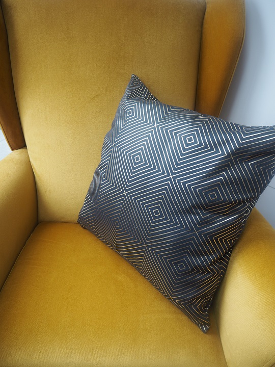 gray and gold cushion